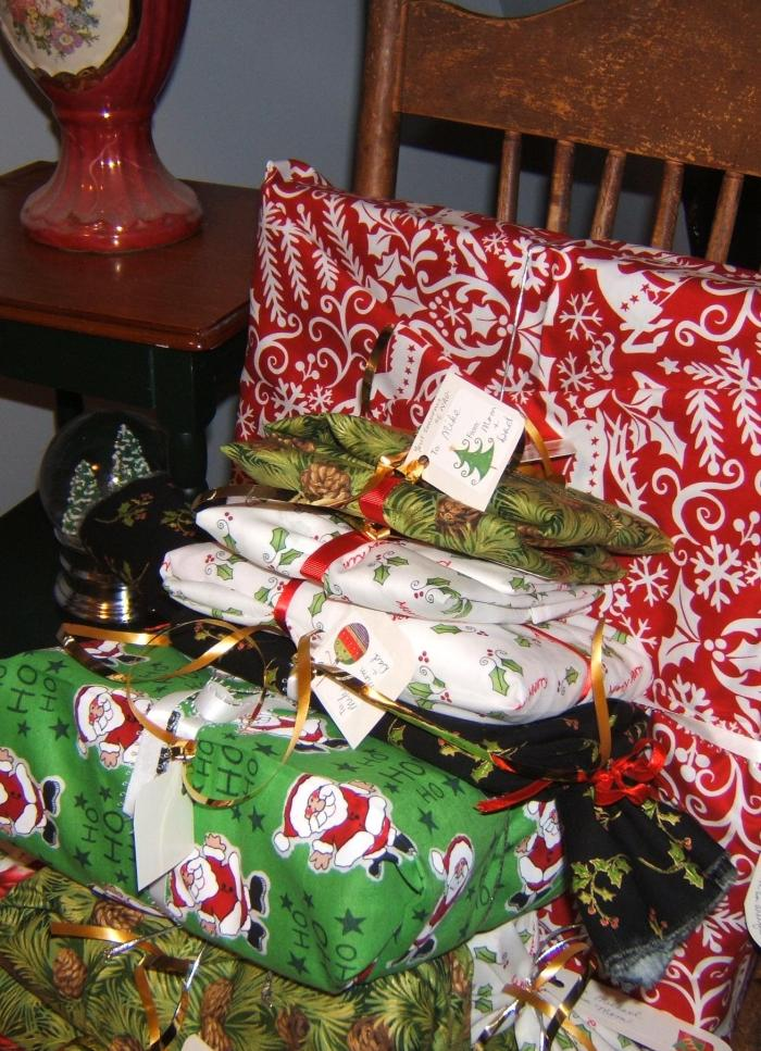 pile of gifts wrapped in fabric