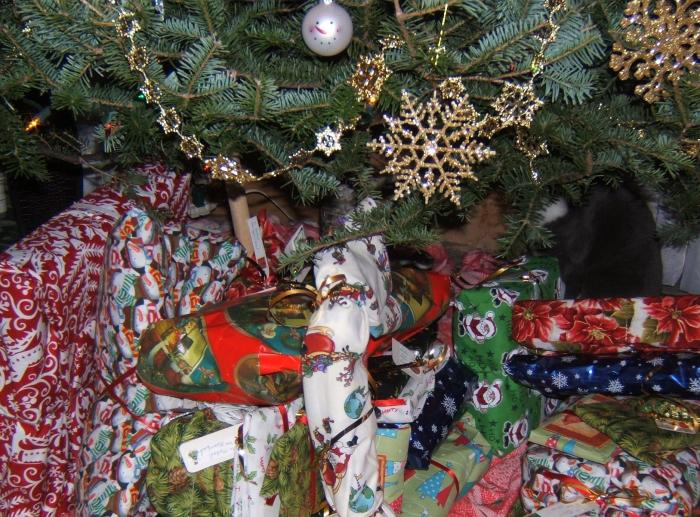 fabric wrapped gifts under the tree
