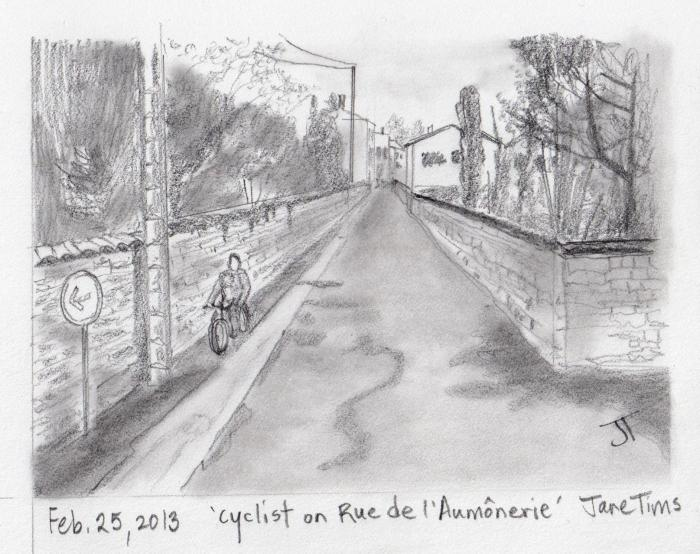 'cyclist on Rue de l'Aumonerie'