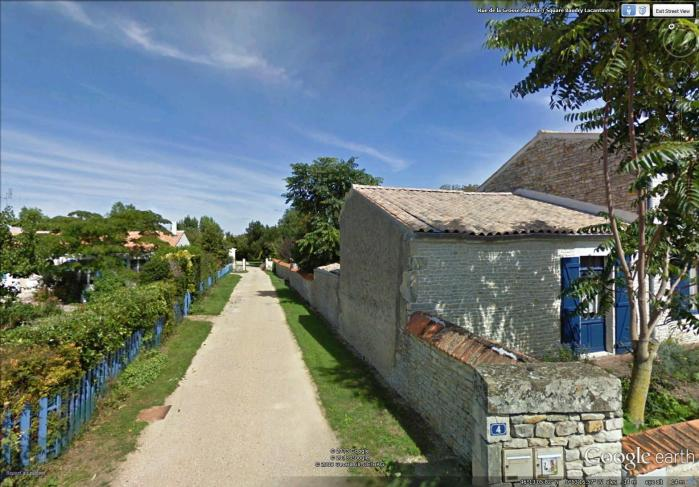 narrow alley in the village (image from Street View)