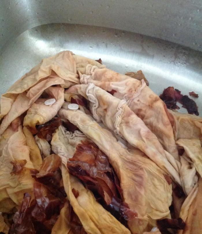 cotton shirt and onion skins released to the sink