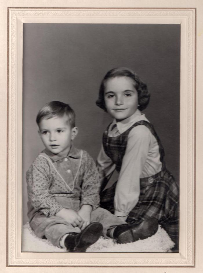 My brother and I in 1960 - I had been in Grade One for three months when the picture was taken - I look like I could easily make those seven blocks to school!