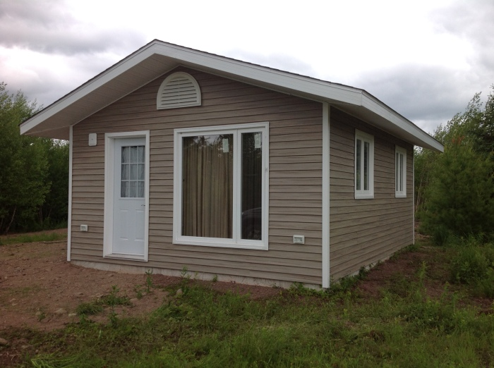 our cabin, all the windows in and siding complete 2014
