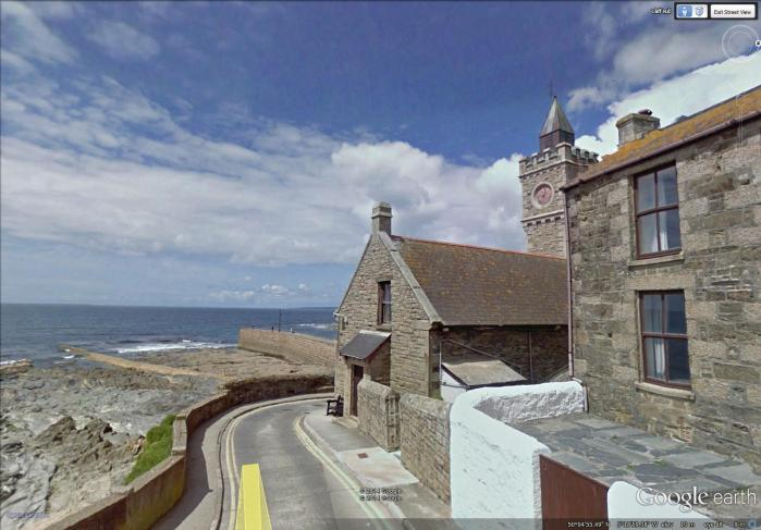 seawall and clock tower at Porthleven (image from Street View)