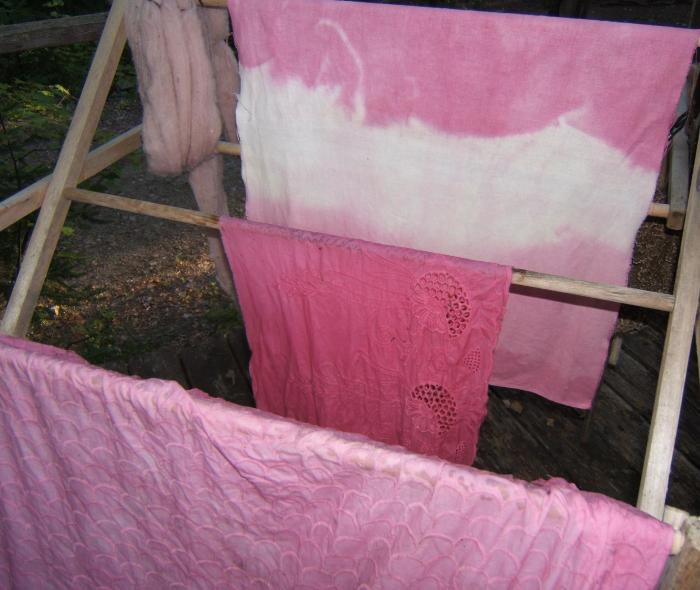 back left to front: wool, linen, cotton and another cotton, dyed with blackberries