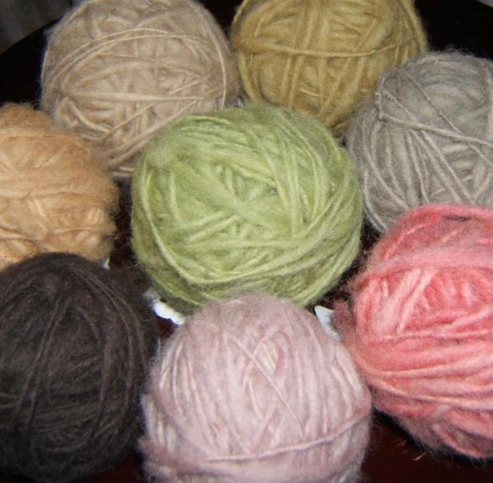 pink wool dyed with blackberries is front and center ... other wools are dyed with (clockwise) oak, meadowsweet, bugleweed, tansy, lily-of-the-valley, beet root, and in the center, carrot tops