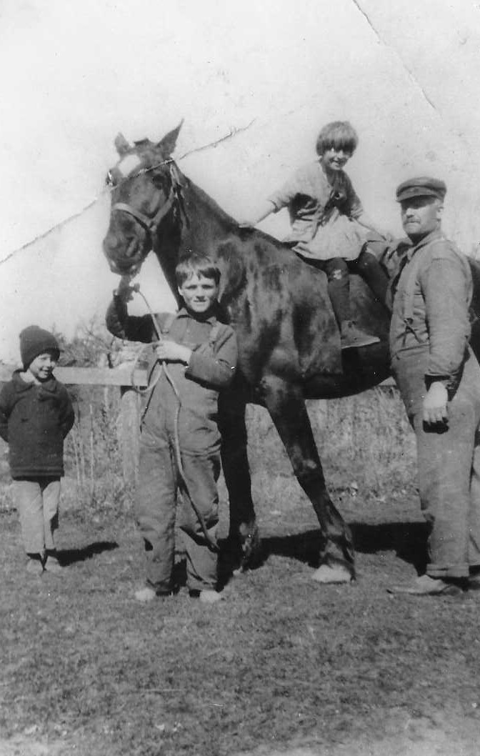 Dad as a boy holding horse